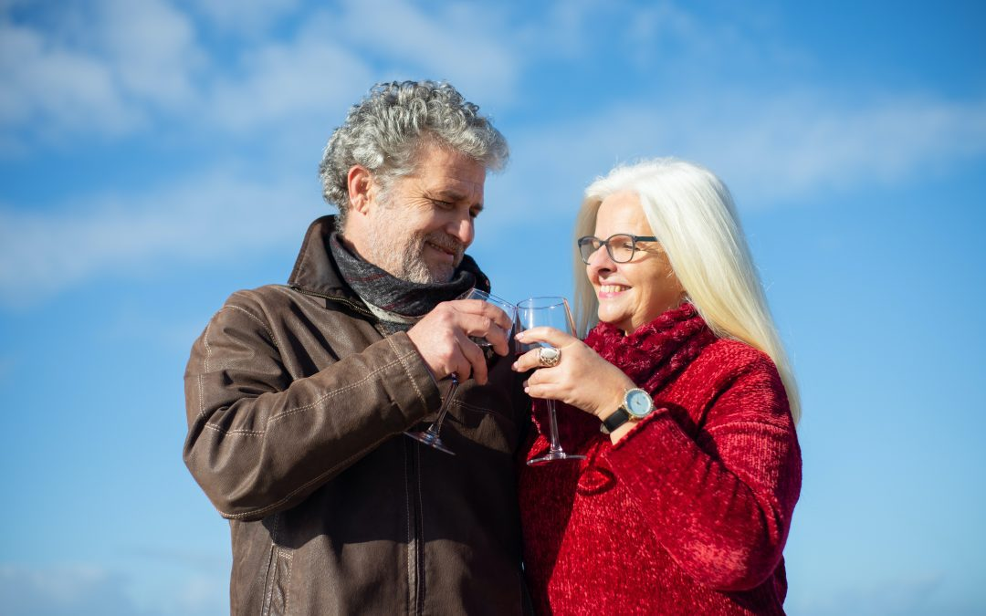elderly couple drinking wine
